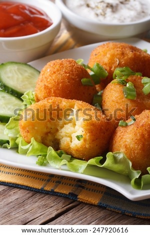 Potato balls deep fried on a plate close-up. vertical  - stock photo