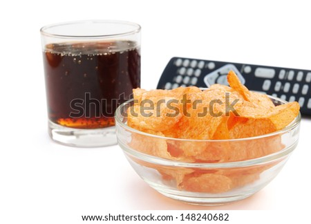 potato chips and cola and remote controll with clipping path - stock photo