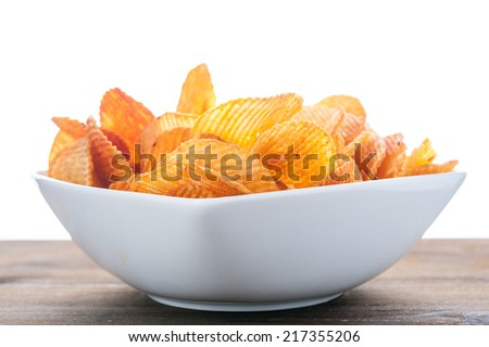 Potato chips bowl on table - stock photo