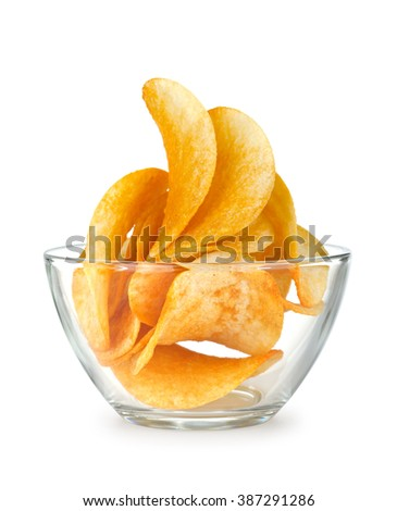 potato chips in a glass bowl on an isolated white background  - stock photo