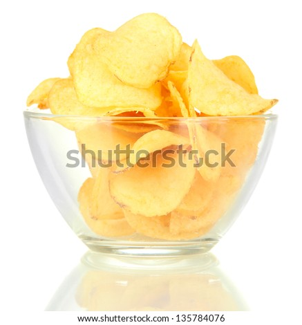 Potato chips in glass bowl, isolated on white - stock photo