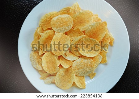 Potato chips in the dish - stock photo