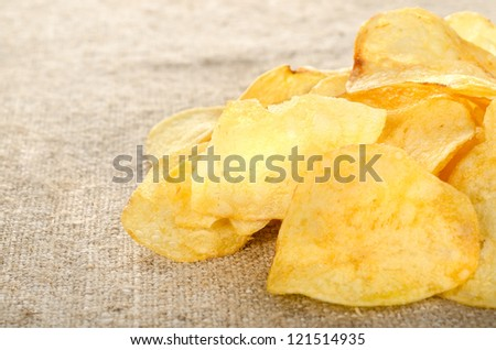 Potato chips on a old brown canvas