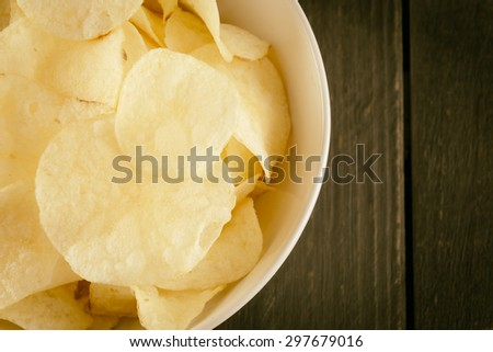 potato chips on wood - soft focus with vintage film filter