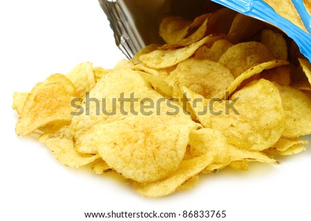 Potato chips poured out from packing on a white background - stock photo