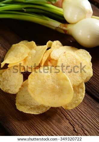 Potato chips- spring onion flavour - stock photo