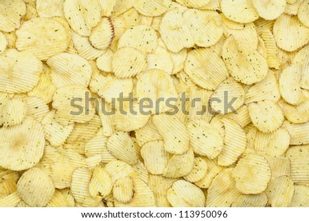 Potato chips with sour cream and spring onions - stock photo