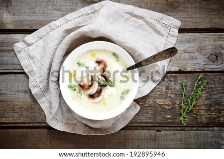 Potato cream soup with mushrooms, thyme and ricotta. Top view. - stock photo