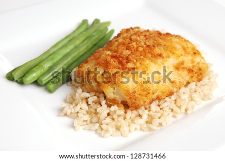 Potato Crusted Cod over Brown Rice (focus on front edge of food)