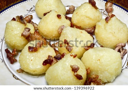 Potato dumplings with meat before cooking. - stock photo
