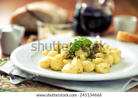 Potato gnocchi with pesto - stock photo