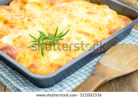 Potato gratin in baking dish - stock photo