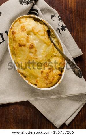 Potato gratin on rustic background - stock photo