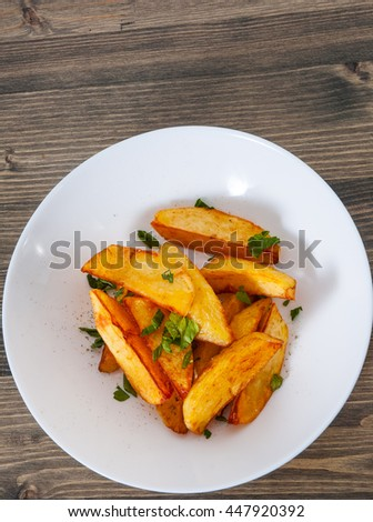potato in a bowl on wooden background - stock photo