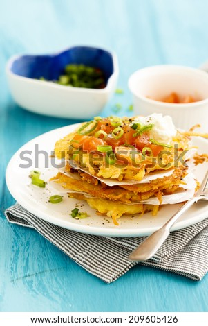 ... latkes with smoked salmon, green onion and goat cheese - stock photo