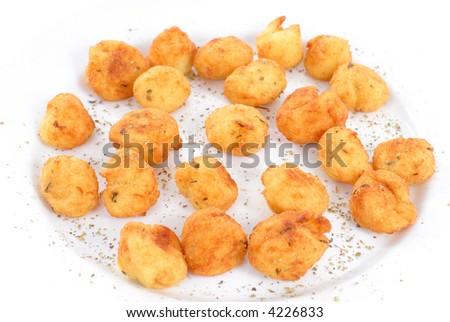 Potato little cakes sprinkled with herbs .