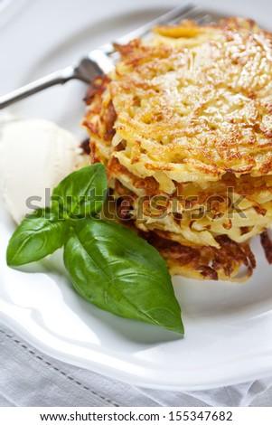 Potato pancakes with sour cream - stock photo