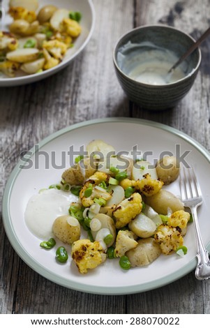 Potato, roast cauliflower and broad bean salad - stock photo