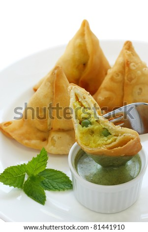 potato samosa with fresh mint dipping sauce , indian food - stock photo