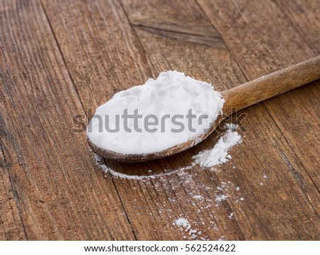 Potato starch on wooden spoon. Cookery - for thickening, cakes etc. Gluten free.