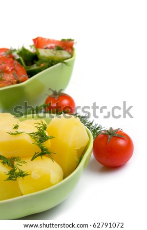 Potatoes and salad on a white background