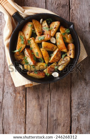 potatoes baked in a pan, rustic style, vertical view from above  - stock photo