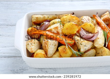 Potatoes baked with carrots and onions, food - stock photo