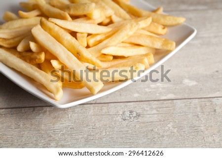 Potatoes fries on wood board - stock photo