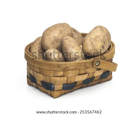 Potatoes in a Basket isolated on a white background. - stock photo