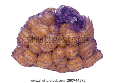potatoes in net packing - stock photo