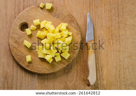potatoes on a wooden board - stock photo