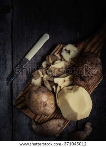Potatoes on wooden boards rustic style in a modern and trendy style.