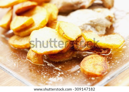 Potatoes over glass plate, shallow depth of field, horizontal image - stock photo