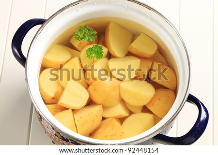 Potatoes ready to be cooked in a pan - stock photo