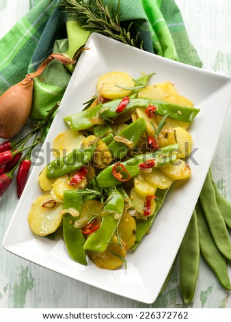 potatoes salad with flat green beans - stock photo
