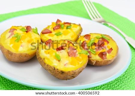 Potatoes Stuffed with Salami Sausage and Yellow Peppers Studio Photo - stock photo