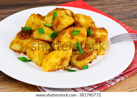 Potatoes with Curry and Breadcrumbs, Garnish Studio Photo