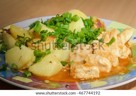 potatoes with meat and green onions
