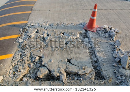 pothole and road surface repairing works - stock photo