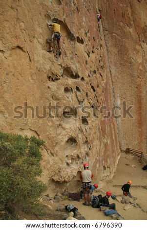 Potholes, climbers on rock face,		Smith Rock State Park, 	Central Oregon - stock photo