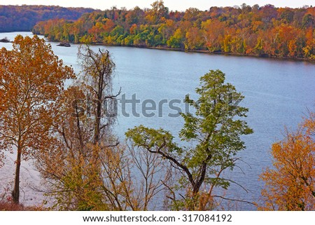 Potomac River with trees in autumn colors in Washington DC, USA. A look on Potomac River in fall from the bridge. - stock photo