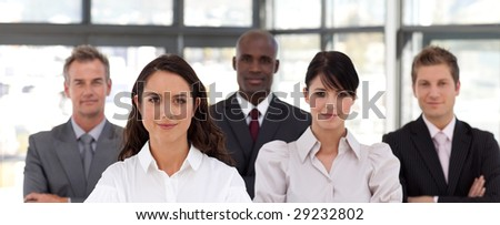 Potrait of a young Confident Business woman leading a team - stock photo