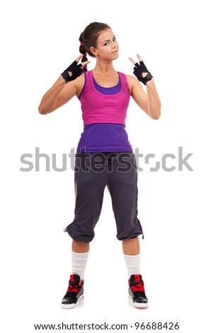 potrait of a young  sporty woman gesturing a  win symbol on white background