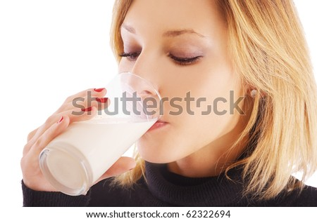 potrait of blonde girl drinking milk from glass - stock photo