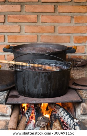 Pots and pans on the stove over a natural fire for cooking a typical brazilian Feijoada