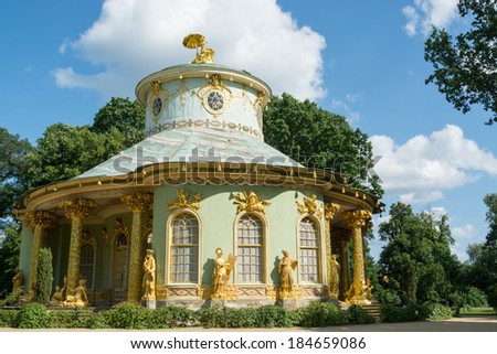 POTSDAM, GERMANY - JULY 15, 2013: Chinese tea house from 18th century, part of Sanssouci park. Sanssouci is the former summer palace of Frederick the Great, King of Prussia. - stock photo