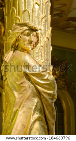 POTSDAM, GERMANY - JULY 15, 2013: Golden statue from in front the Chinese house, part of Sanssouci park (18th century). Sanssouci is the former summer palace of Frederick the Great, King of Prussia. - stock photo