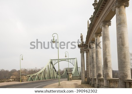 """POTSDAM, MARCH 10: The """"Glienicker Brucke"""" (German for Glienicke Bridge) in Potsdam near Berlin on March 10, 2016. During the Cold War used for the exchange of captured spies. - stock photo"""