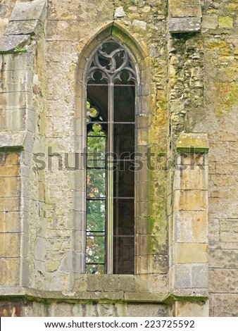 POTTENDORF, AUSTRIA - 15  October 2014: Window of the chapel of the castle Pottendorf, which was abandoned after World War II. The building is currently being renovated.  - stock photo