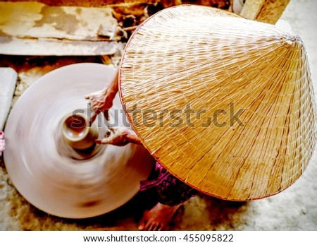 Potter at work on a pottery wheel. Duy Tan village, Hoi An, Vietnam